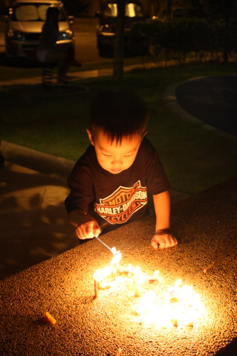 Wei Hao lighting a candle