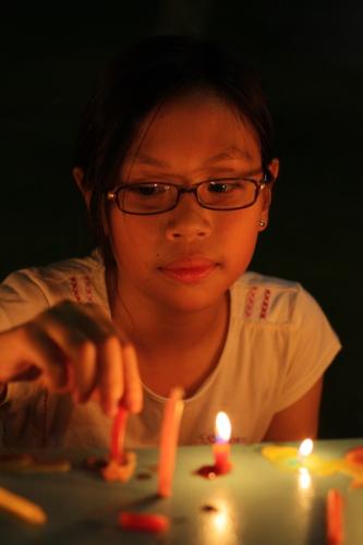 Sam lighting candles