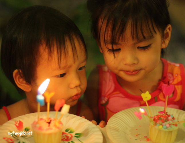 Tasha & Zaria blowing candles