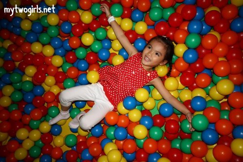 Tasha in pools of balls