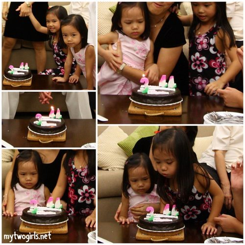 Zaria blowing candles on her cake