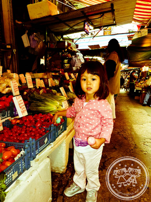 Central Market - Maya checking out vegetables