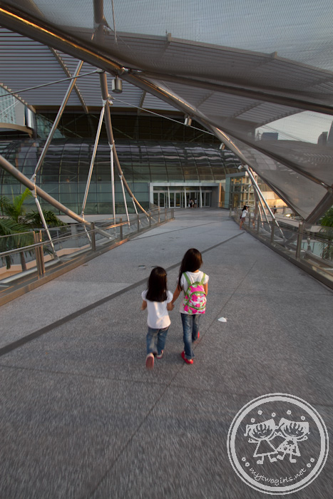 Girls walking towards aircon