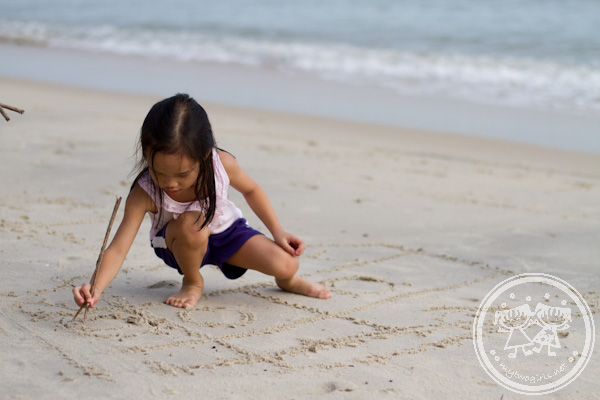 Zaria drawing at the beach