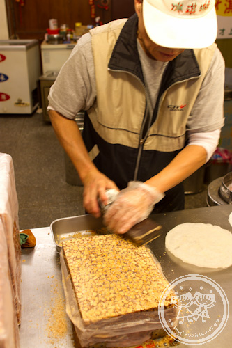 Man shaving peanut brittle