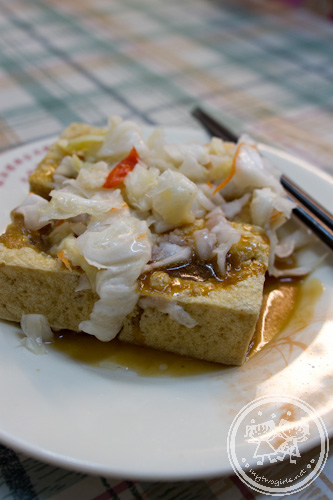 Fried Stinky tofu topped with pickled cabbage