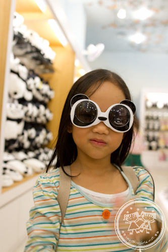 Zaria in Panda sun glasses