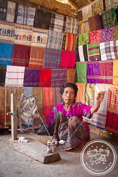 Sasak woman on spinning loom