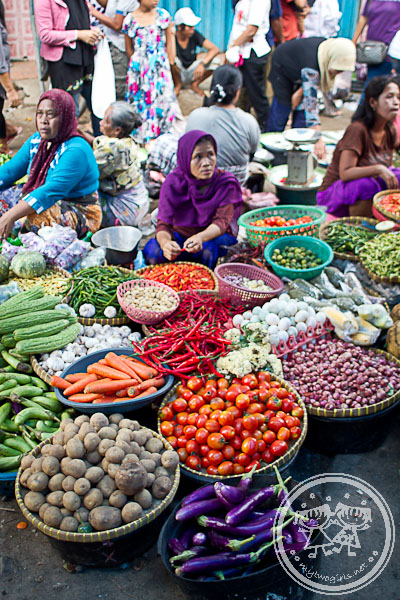 Vegetable Seller At Kebon Roek Market. Most of the vegetables are grown locally in Lombok