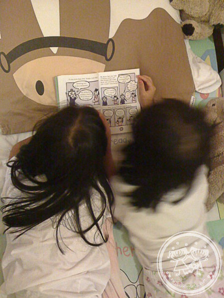 Girls reading a comic together