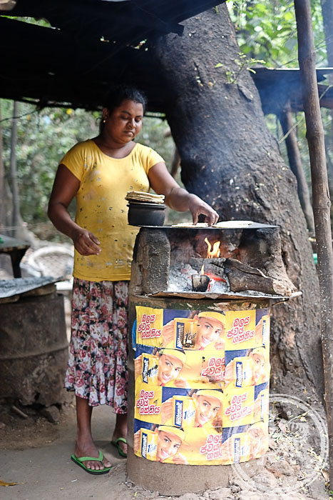 Lady heating up Roti