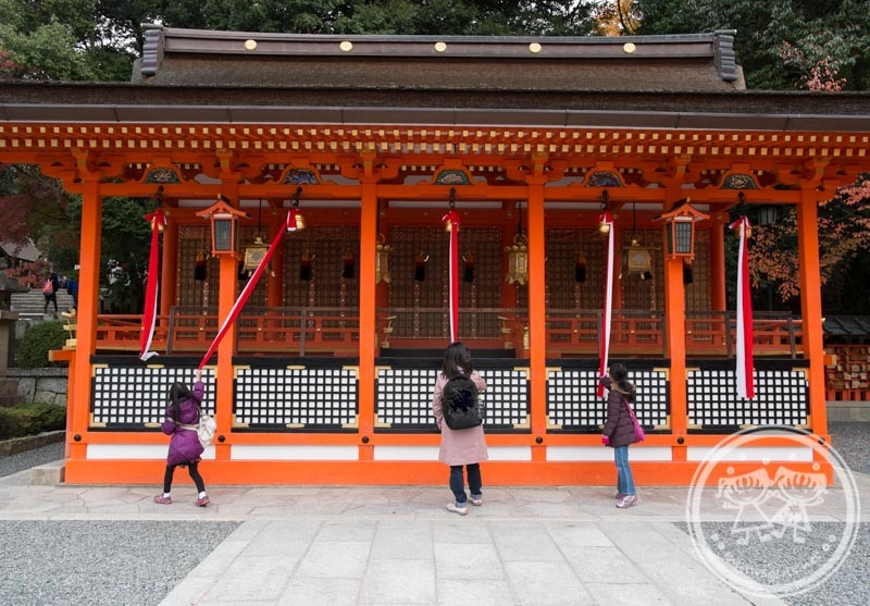 Making a wish at Fushimi Inari Shrine