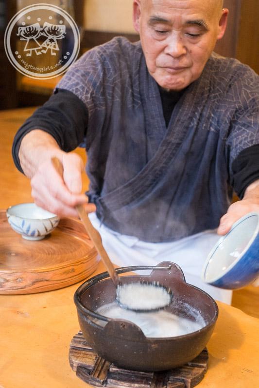 Turuturutei owner scooping soba soup