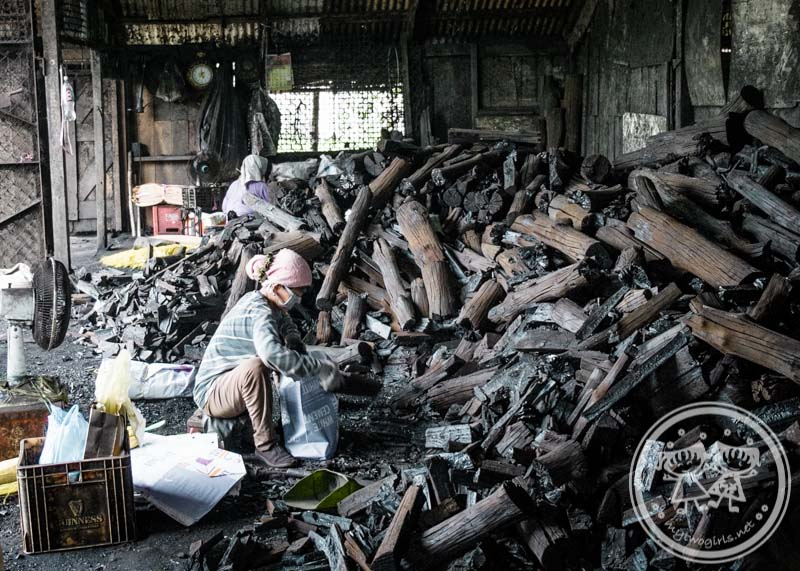"Sorting out charcoal at Kuala Sepetang Charcoal Factory"" title="