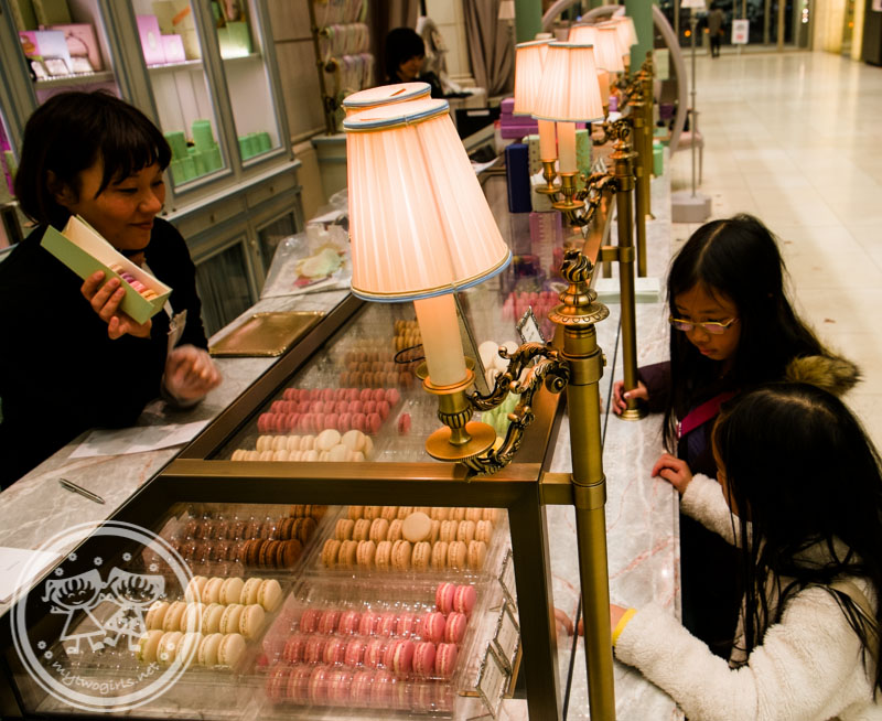 Choosing macaron flavours at Laduree Daimaru